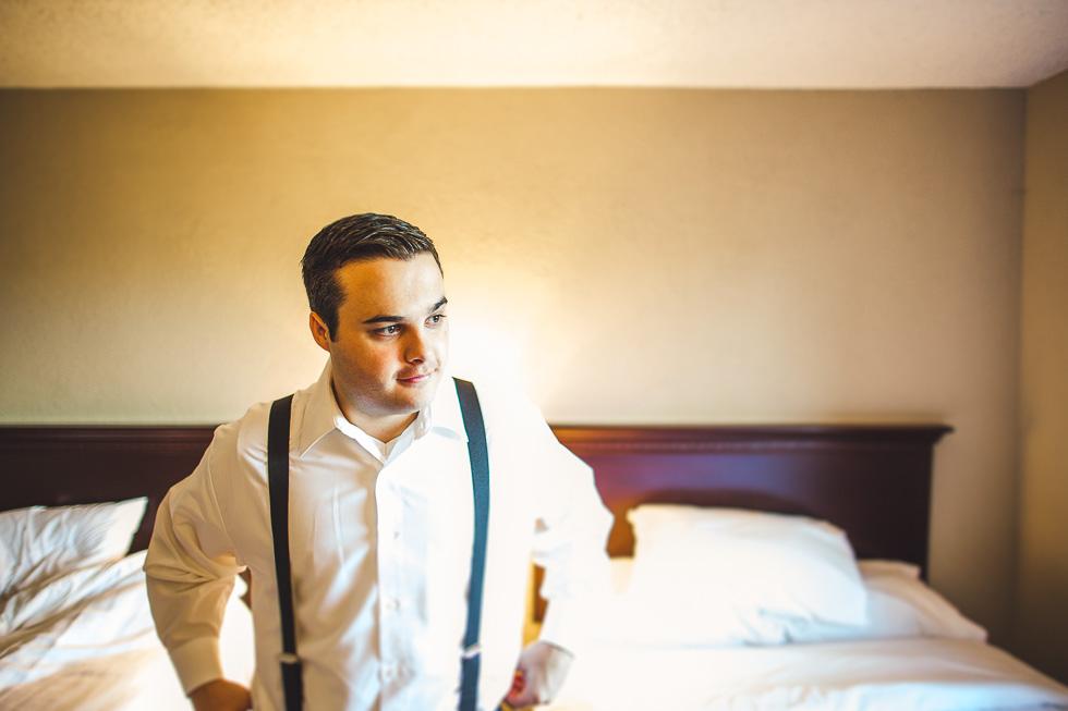 1-groom-in-hotel-room-getting-ready