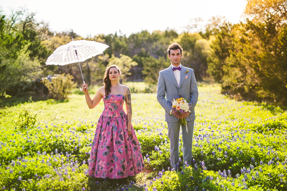 18-wildflower-barn-wedding-photos-bluebonnets-field-umbrella-tattoos