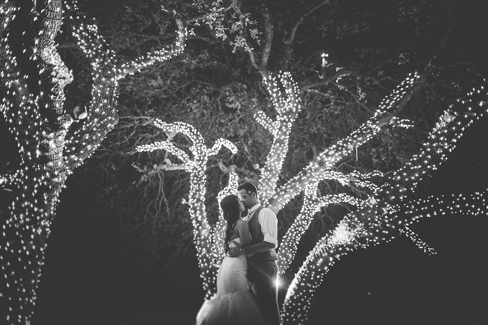 15-antebellum-oaks-austin-spring-wedding-bride-groom-night-lights-trees-photographer-andyandcarriephoto