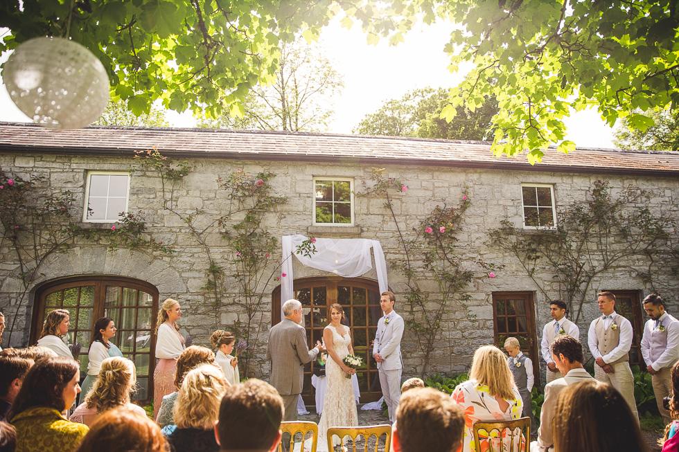 15-destination-wedding-galway-ireland-ross-castle-outdoor-wedding-garden-roses-ceremony-andyandcarriephoto