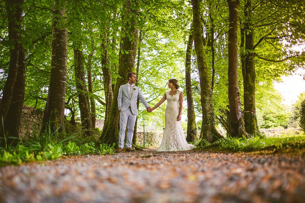 27-destination-wedding-galway-ireland-ross-castle-trees-moss-stones-bride-groom-andyandcarriephoto