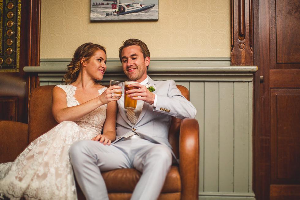 32-destination-wedding-galway-ireland-mcswiggans-restaurant-reception-beer-cheers-bride-groom-andyandcarriephoto