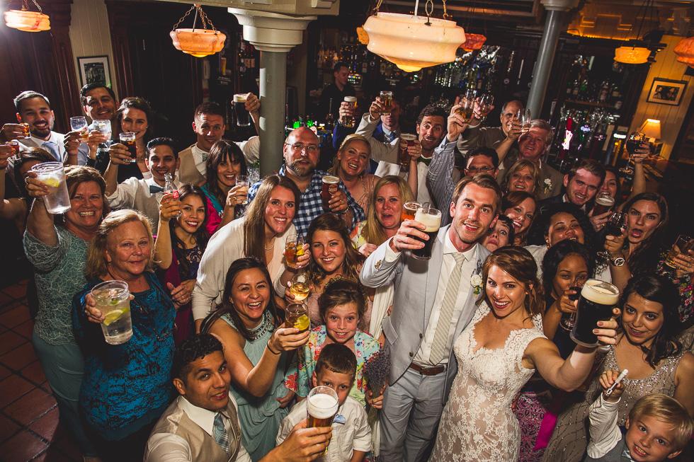 33-destination-wedding-galway-ireland-mcswiggans-pub-restaurant-reception-beers-cheers-entire-wedding-party-photo-andyandcarriephoto
