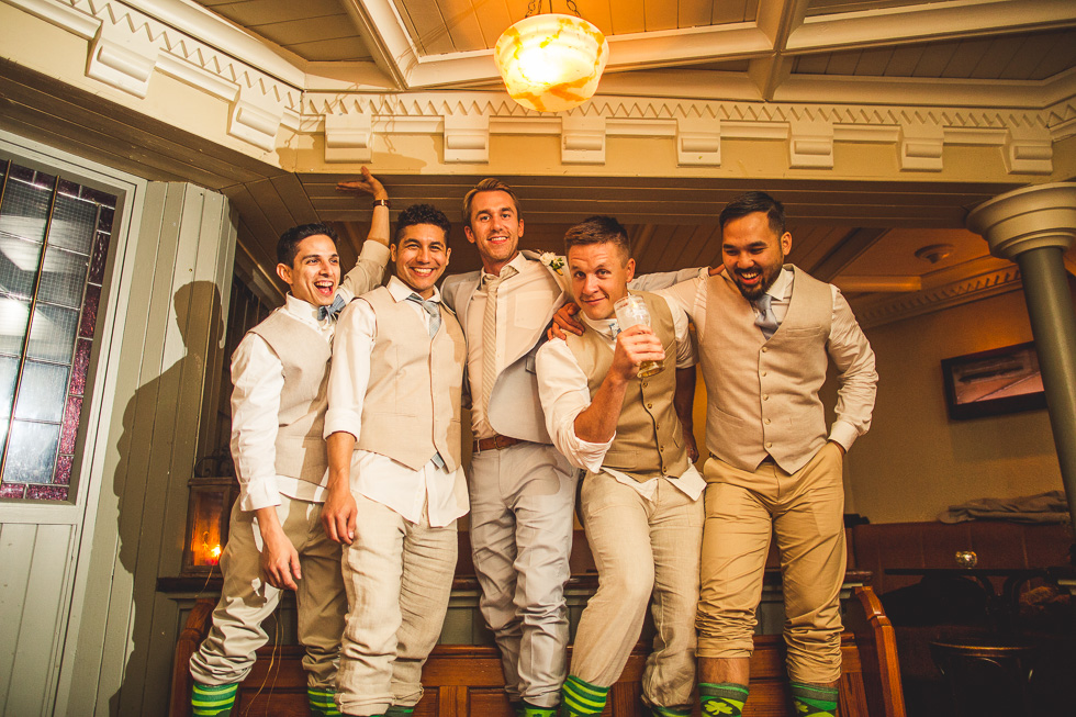 39-destination-wedding-galway-ireland-mcswiggans-restaurant-pub-reception-groomsmen-matching-irish-socks-andyandcarriephoto