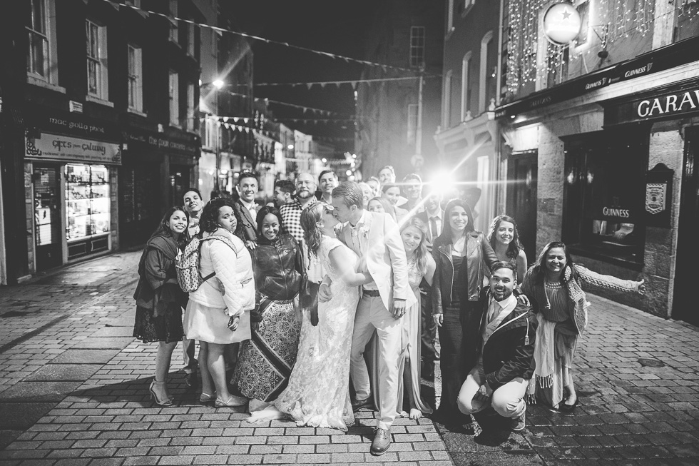 40-destination-wedding-galway-ireland-reception-group-photo-streets-pub-andyandcarriephoto