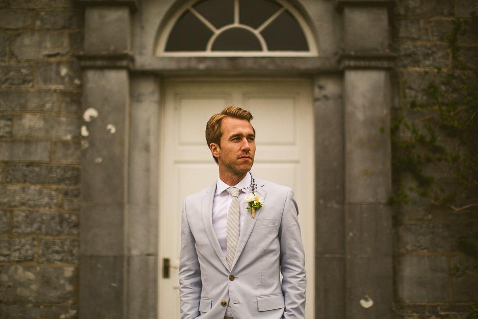 8-destination-wedding-galway-ireland-ross-castle-light-grey-suit-groom-andyandcarriephoto