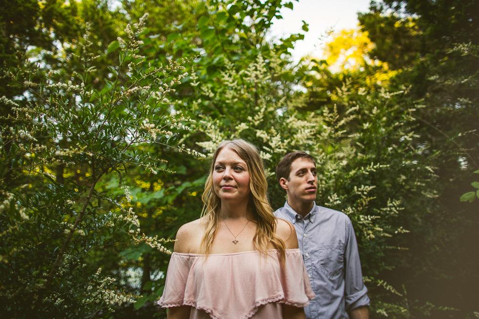 8-red-bud-isle-austin-engagement-photographer-couple-trees-photo-pink-blouse-blue-shirt