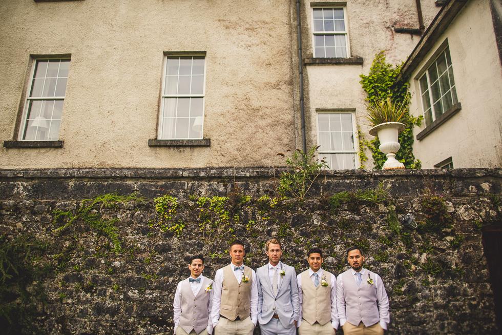 9-destination-wedding-galway-ireland-ross-castle-groomsmen-wall-andyandcarriephoto